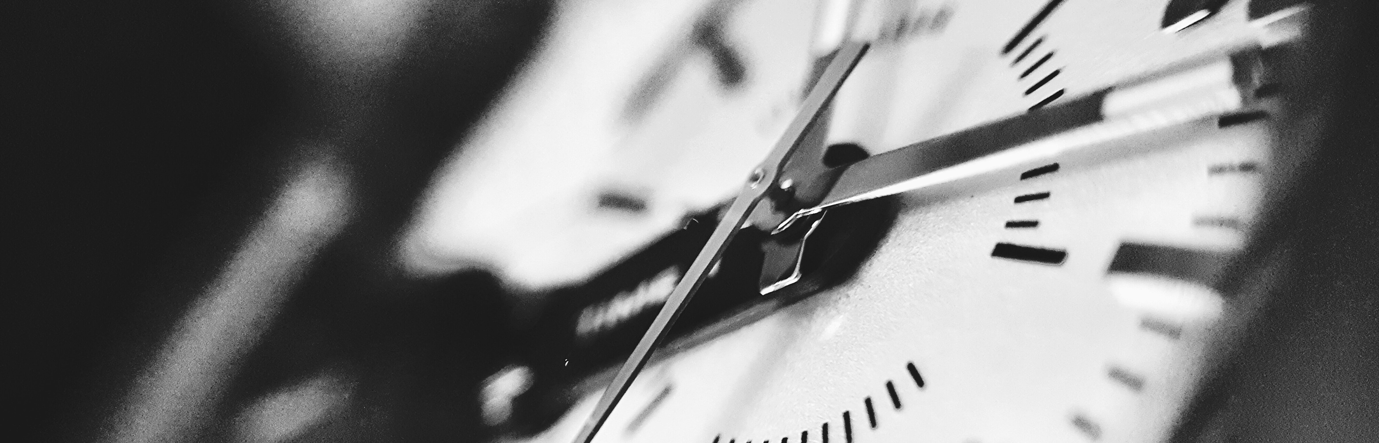 Black and white close up of an analog wall clock